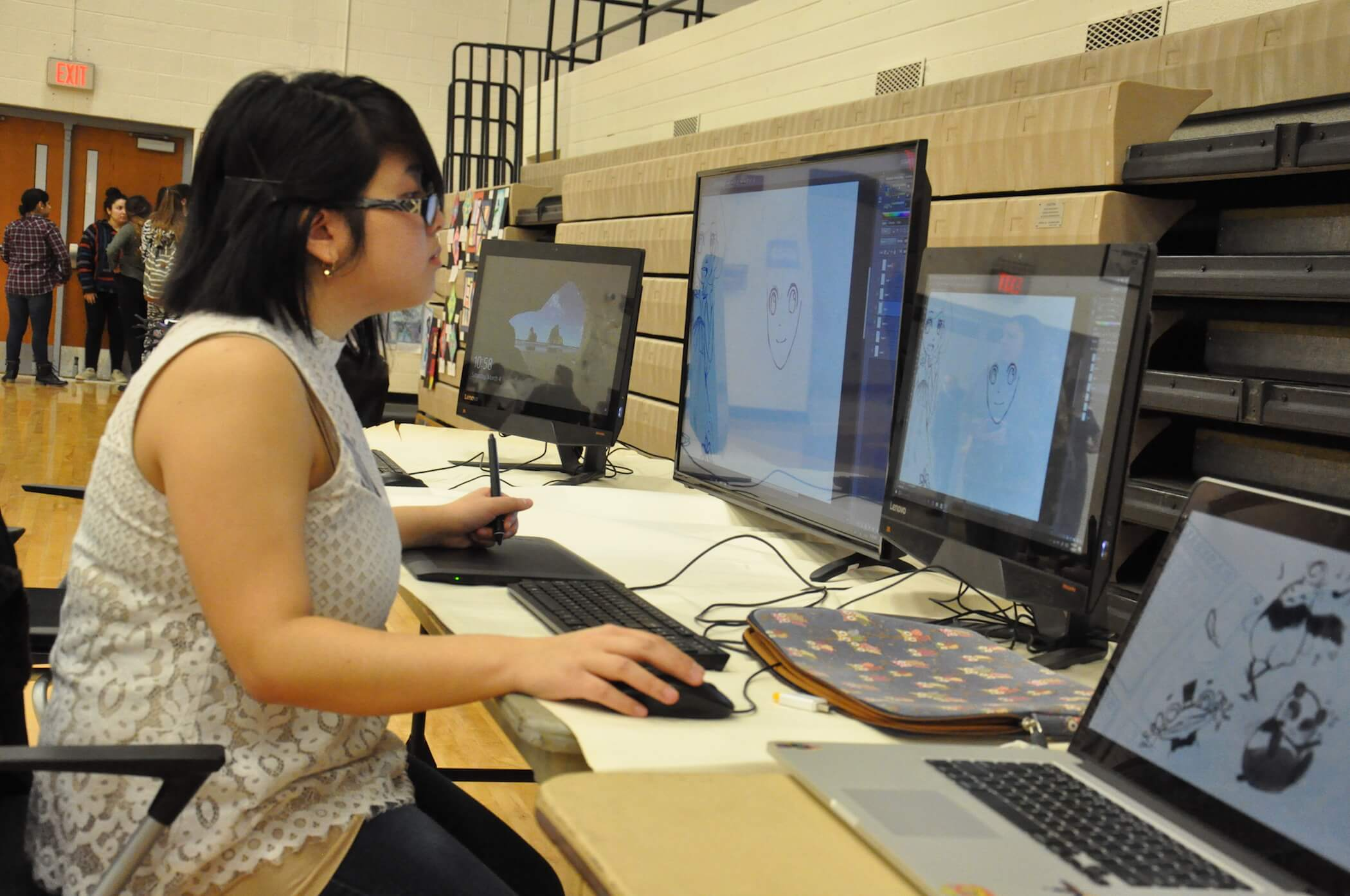 Photo of female student working at a computer.